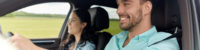 leisure, road trip, travel, family and people concept - happy man and woman driving in car